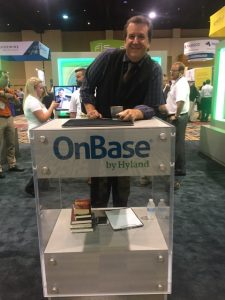 Magician David Harris at the Onbase booth at a trade show