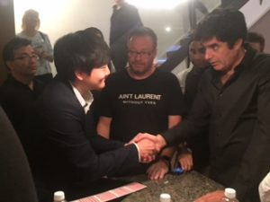Ed Kwon shaking David Copperfield's hand